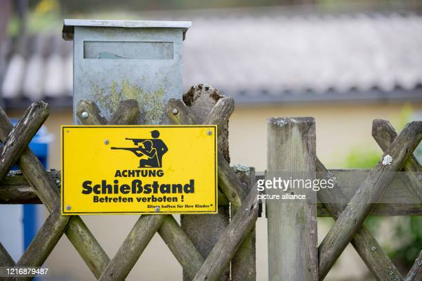 """May 2020, Brandenburg, Gadow, Wittstock/Dosse: """"Attention firing range. No trespassing! Parents are liable for their children"""" is written on a sign..."""
