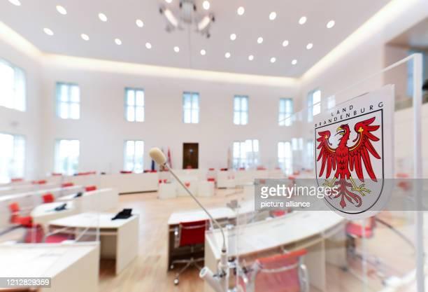 May 2020, Brandenburg, Potsdam: The Brandenburger Adler is attached to a Plexiglas panel in the plenary hall of the Brandenburg state parliament....