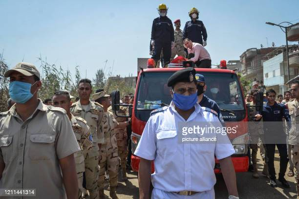 May 2020, Egypt, Demshelt: Army soldiers march next to a fire truck carrying the body of Egyptian army officer Abdelhamid Sobhi during his funeral at...