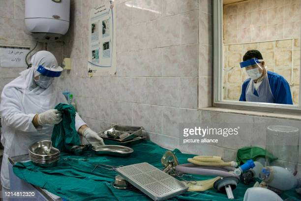 A picture made available on 23 May 2020 shows medics disinfecting surgical instruments at the 6th Of October Central Hospital which has been...