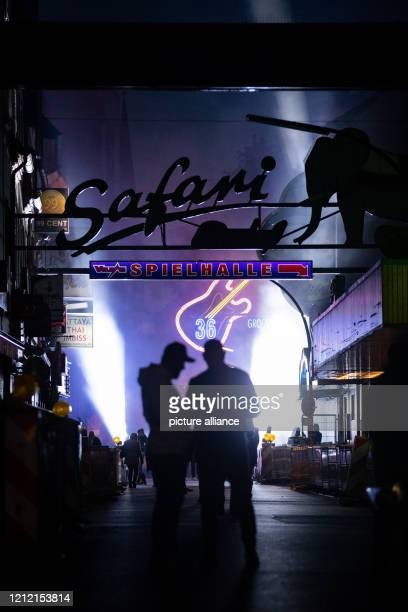 """Passers-by walk through the street """"Große Freiheit"""" on the Reeperbahn at the end of a protest action by neighbourhood restaurateurs, club and pub..."""