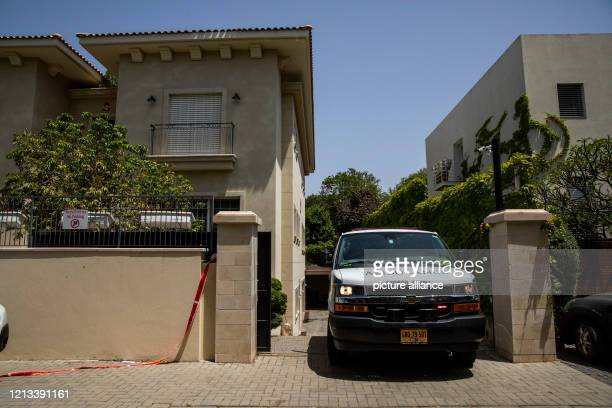 An ambulance transports the body of the Chinese Ambassador to Israel Du Wei leaves his residence after he was found dead Photo Ilia Yefimovich/dpa