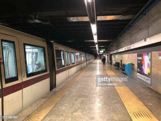 """May 2020, Italy, Rom: Almost empty is one station of the subway line """"B"""". After almost two long months, Italy has relaxed the curfews, which were..."""