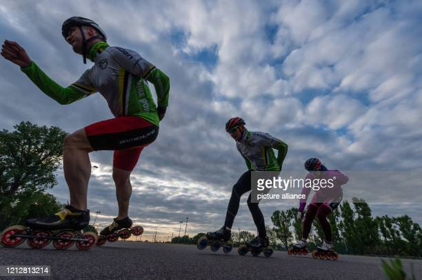 May 2020, Saxony, Dresden: Speed skaters train in the evening in the Ostra Sports Park. Sports facilities for club sports have been reopened with...