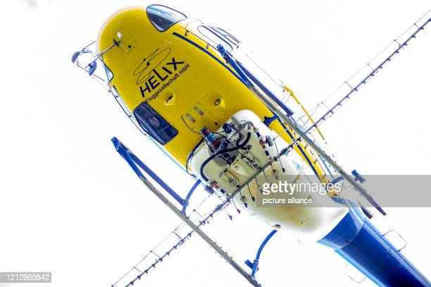 A helicopter with a spraying device and a tank for a food poison flies in the sky In the district of Stendal the fight against the oak processionary...
