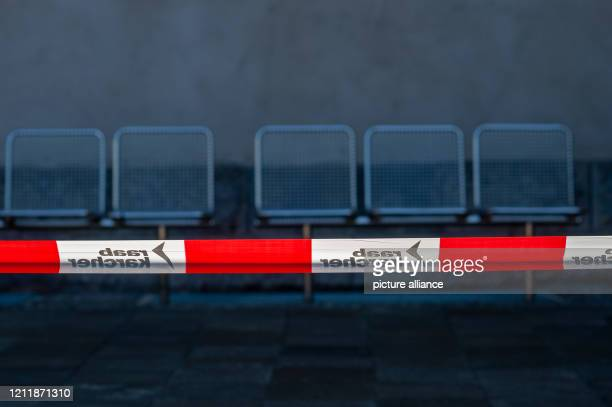 May 2020, Saxony-Anhalt, Magdeburg: A barrier tape is stretched in front of the Museum of Natural History in front of seats. In the museum, the...