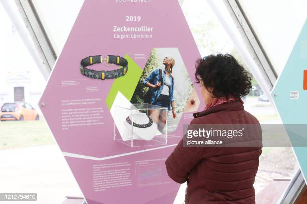 May 2020, Thuringia, Gera: A visitor looks at an information board in the climate pavilion. The Climate Pavilion offers a varied programme on the...