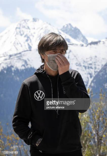 May 2021, Austria, Mösern: German coach Joachim Löw stands in front of the Hotel Nidum, where the German national football team will stay during...