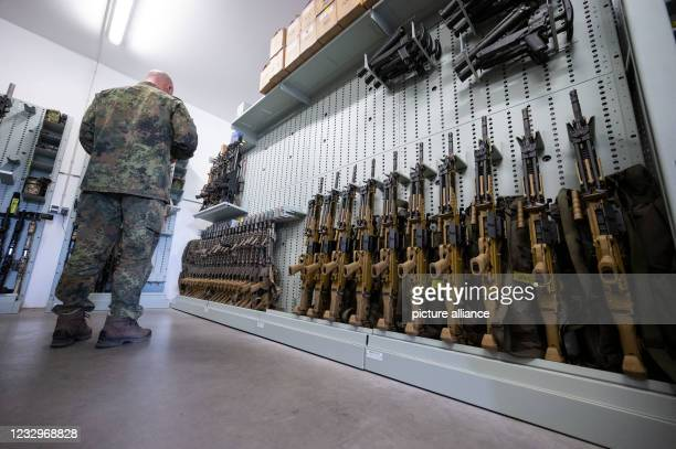 May 2021, Baden-Wuerttemberg, Calw: A member of the support forces of the Bundeswehr Special Forces Command stands in an armory at the KSK site....