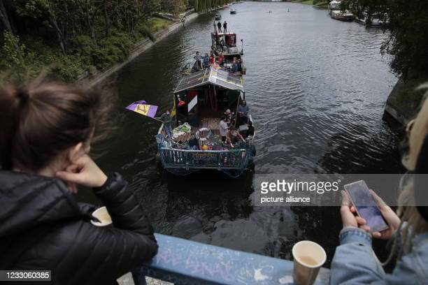 """Participants of a demonstration on water under the motto """"Against the rent madness - now more than ever!"""" protest on boats on the Spree. The boat and..."""