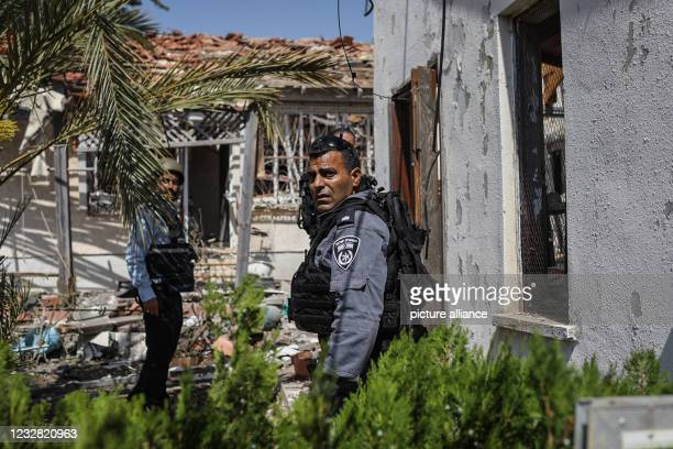 May 2021, Israel, Ashkelon: Security forces inspect a damaged building that was hit by rockets fired from the Gaza Strip towards the city of...