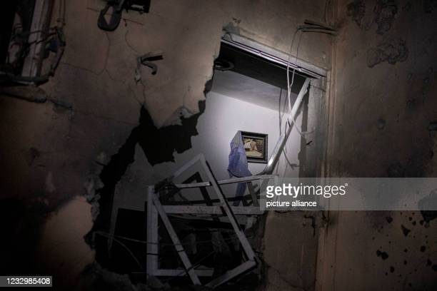 May 2021, Israel, Sderot: A general view of a hole at a damaged house that was directly hit by a rocket fired from the Gaza Strip amid the escalating...