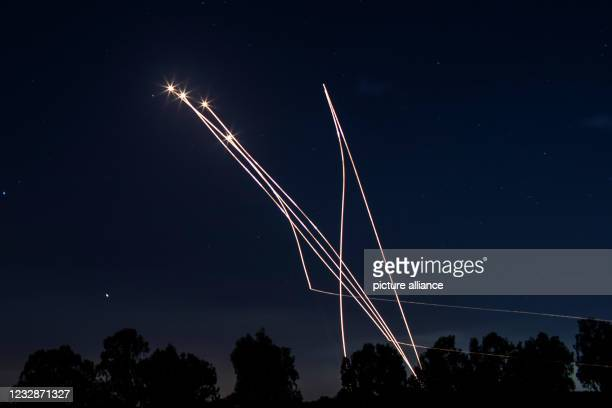 May 2021, Israel, Sderot: Israeli Iron Dome missiles intercept rockets fired from the Gaza Strip towards Israel, amid the escalating flare-up of...
