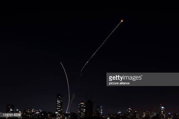 May 2021, Israel, Tel Aviv: Israeli Iron Dome missiles intercept rockets fired from the Gaza Strip towards Israel, amid the escalating flare-up of...
