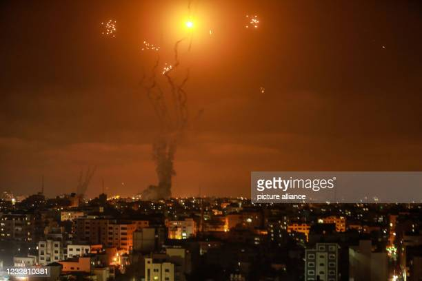 May 2021, Palestinian Territories, Gaza City: Israel's Iron Dome aerial defence system intercepts rockets fired by the Palestinian Islamist movement...