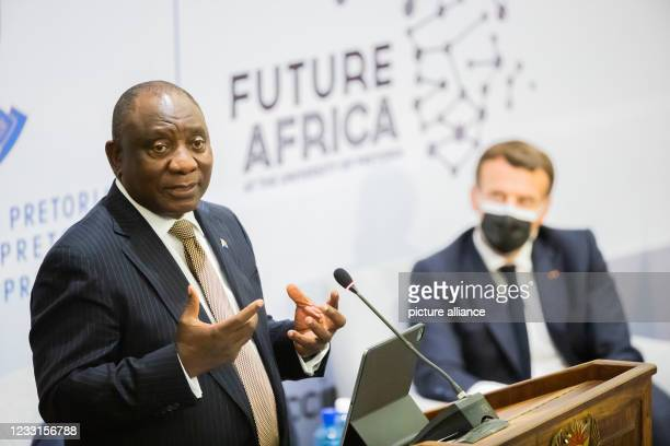 May 2021, South Africa, Pretoria: Cyril Ramaphosa , President of South Africa, speaks alongside Emmanuel Macron, President of France, at the launch...