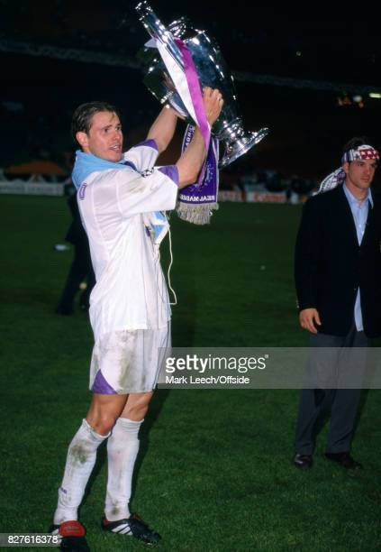 May 20th 1998 UEFA Champions League Final Real Madrid vs Juventus Redondo of Real Madrid shows the UEFA Champions League Trophy to the Real Madrid...