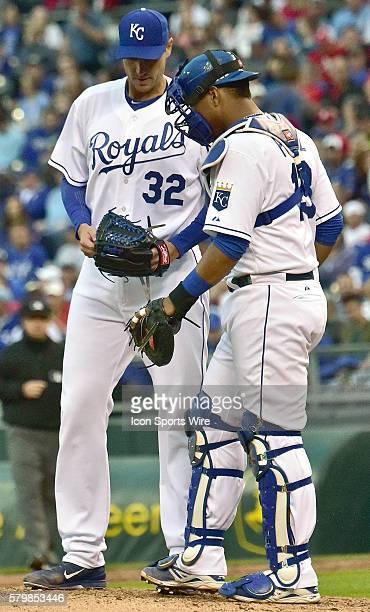Kansas City Royals' catcher Salvador Perez talks with Kansas City Royals' starting pitcher Chris Young during an MLB interleague baseball game...