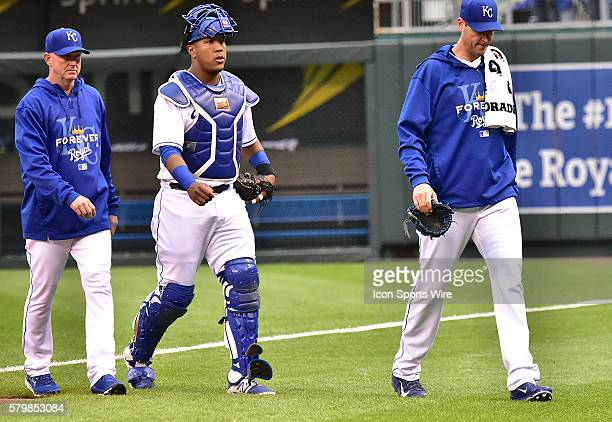 Kansas City Royals' starting pitcher Chris Young heads for the dugout at the start of the game along with Kansas City Royals' catcher Salvador Perez...