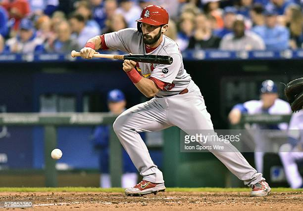 St Louis Cardinals' third baseman Matt Carpenter bunts in the seventh inning during an MLB interleague baseball game between the St Louis Cardinals...
