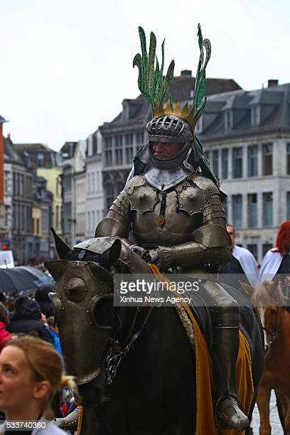 A knight takes part in the Doudou festival held in Mons Belgium May 22 2016 The Doudou Festival contains two important parts Procession du Car d'Or...