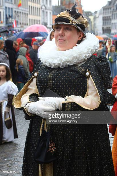 A woman takes part in the Doudou festival held in Mons Belgium May 22 2016 The Doudou Festival contains two important parts Procession du Car d'Or...