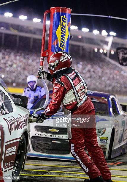 Sprint Cup Series driver Ryan Newman pit crew member fills car with gas during a pit stop at Charlotte Motor Speedway during Coca Cola 600 in Concord...