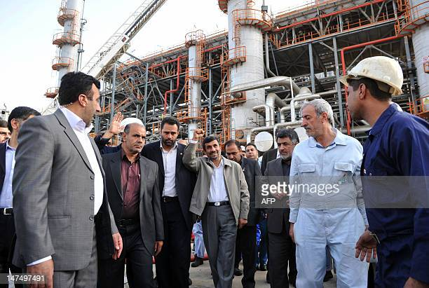 A May 24 file photo shows Iranian President Mahmoud Ahmadinejad gesturing as he tours the Abadan oil refinery during the inauguration of a petrol...