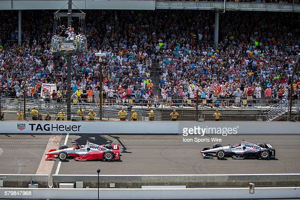 IndyCar Driver Juan Pablo Montoya takes the checkered flag to win the running of the the Greatest Spectacle in Racing the 99th Indianapolis 500 over...