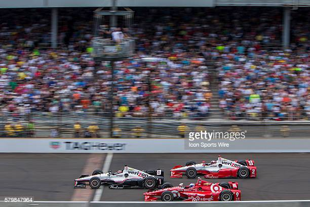 IndyCar Driver Will Power battles for the lead with IndyCar Driver Juan Pablo Montoya and IndyCar Driver Scott Dixon during the running of the the...