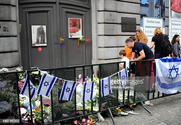 May 25, 2014 dated pictures show people gather out front of the Jewish Museum in Brussels to commemorate four people who were killed in Saturdays,...