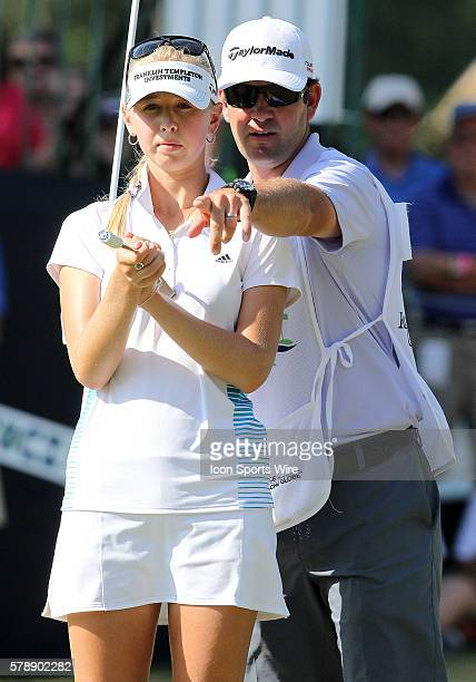 Jessica Korda of Bradenton Florida and her caddie plan their strategy at the eighteenth hole during the final round of the Airbus LPGA Classic at...