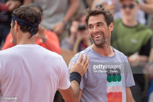 May 25 Roger Federer of Switzerland and Jeremy Chardy of France after training training on Court Suzanne Lenglen in preparation for the 2019 French...