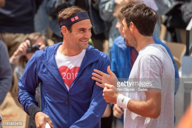 May 25 Roger Federer of Switzerland and Jeremy Chardy of France before training on Court Suzanne Lenglen in preparation for the 2019 French Open...