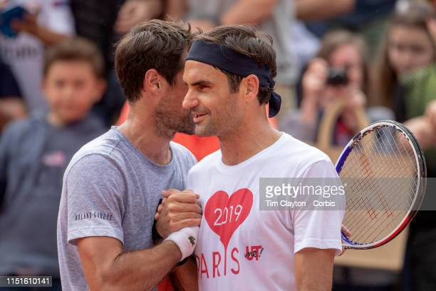 May 25 Roger Federer of Switzerland and Jeremy Chardy of France embrace after training training on Court Suzanne Lenglen in preparation for the 2019...