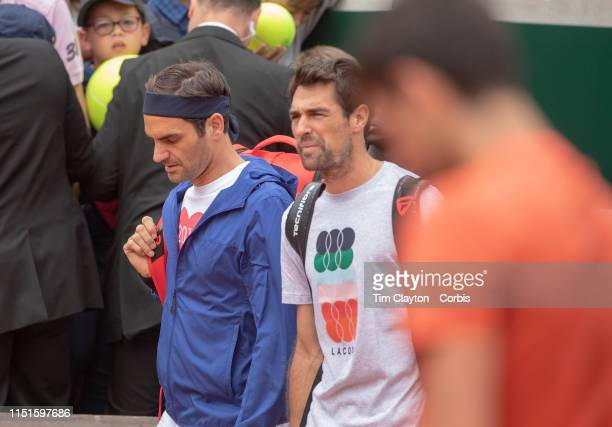 May 25 Roger Federer of Switzerland arrives as Novak Djokovic of Serbia trains on Court Suzanne Lenglen in preparation for the 2019 French Open...