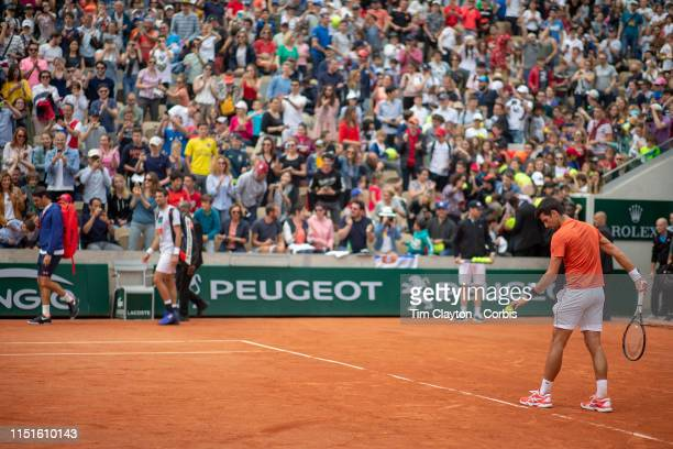May 25 Roger Federer of Switzerland arrives to a standing ovation as Novak Djokovic of Serbia trains on Court Suzanne Lenglen in preparation for the...