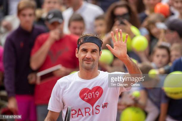 May 25 Roger Federer of Switzerland salutes the spectators after training on Court Suzanne Lenglen in preparation for the 2019 French Open Tennis...