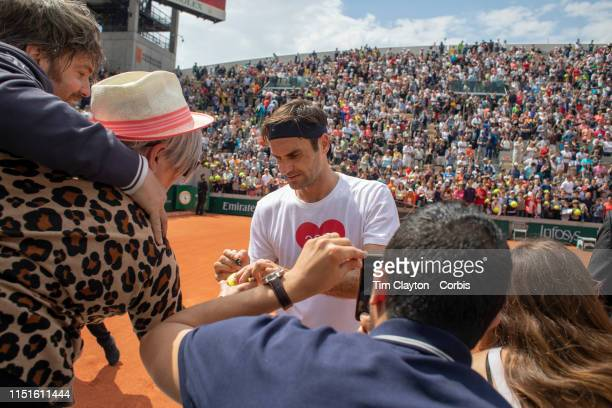 May 25 Roger Federer of Switzerland signing autographs after training on Court Suzanne Lenglen in preparation for the 2019 French Open Tennis...