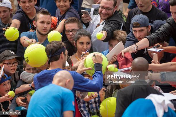 May 25 Roger Federer of Switzerland signing autographs on Court Suzanne Lenglen in preparation for the 2019 French Open Tennis Tournament at Roland...