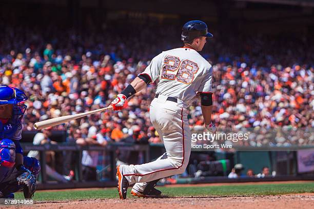 San Francisco Giants catcher Buster Posey follows the trajectory of the ball from t home plate during the game between the San Francisco Giants and...