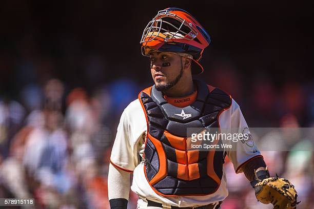 San Francisco Giants catcher Hector Sanchez turns to look at the umpire after a call during the game between the San Francisco Giants and the Chicago...