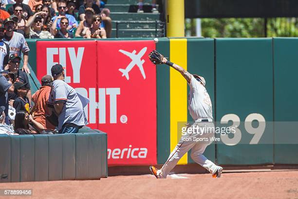 San Francisco Giants left fielder Michael Morse reaches to catch fly foul ball during the game between the San Francisco Giants and the Chicago Cubs...