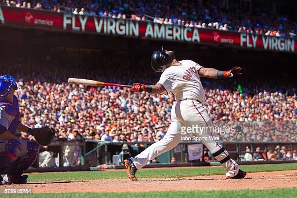 San Francisco Giants third baseman Pablo Sandoval follows the trajectory of the ball after he connected at home plate during the game between the San...
