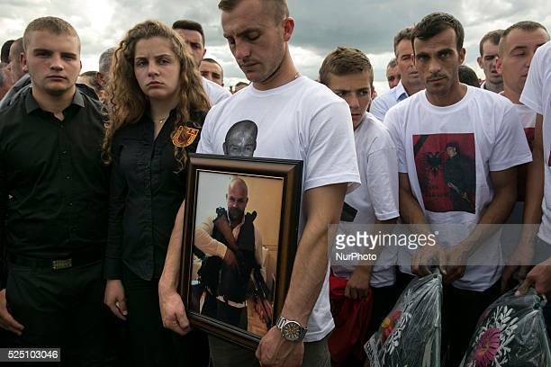 PRISTINA KOSOVO May 26 2015 Family members remember Mirsad Ndrecai one of eight Kosovar men accused of being terrorists during a funeral for eight...