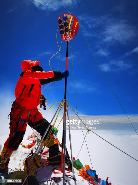 May 27, 2020 -- A Chinese surveyor conducts surveying atop Mount Qomolangma on May 27, 2020. A Chinese surveying team reached the summit of Mount...