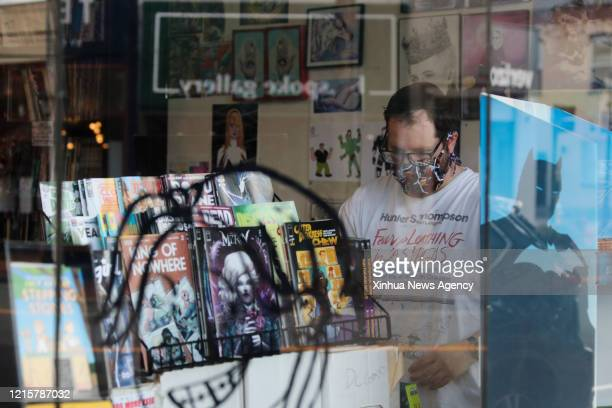 May 27, 2020 -- A worker wearing a face mask arranges books at a book store in Huntington of Suffolk County of New York State, the United States, May...