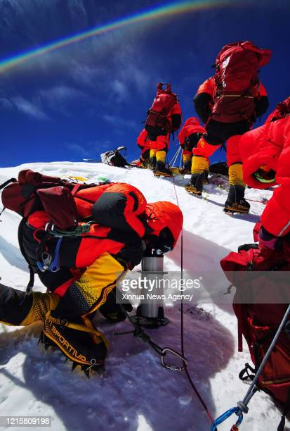 May 27, 2020 -- Chinese surveyors conduct surveying atop Mount Qomolangma on May 27, 2020. A Chinese surveying team reached the summit of Mount...