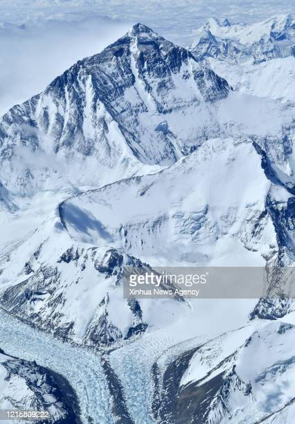 May 27, 2020 -- Mount Qomolangma, the world's highest peak, is seen in this aerial photo taken on May 14, 2020. A Chinese surveying team reached the...