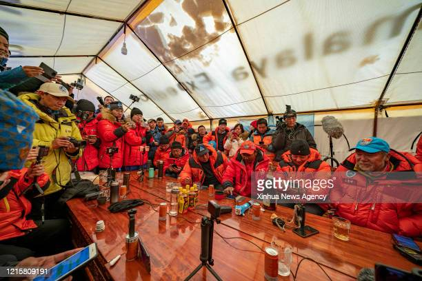 May 27, 2020 -- Staff members gather at a command center at the Mount Qomolangma base camp in southwest China's Tibet Autonomous Region, May 27,...